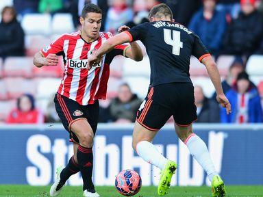 Jack Rodwell of Sunderland takes on Shaun Hutchinson of Fulham