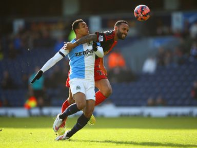 Kyle Bartley of Swansea tangles with Blackburn's Joshua King