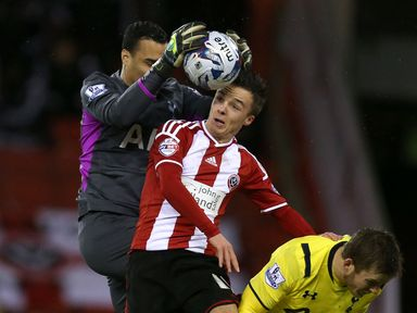 Michel Vorm claims the ball off the head of Stefan Scougall