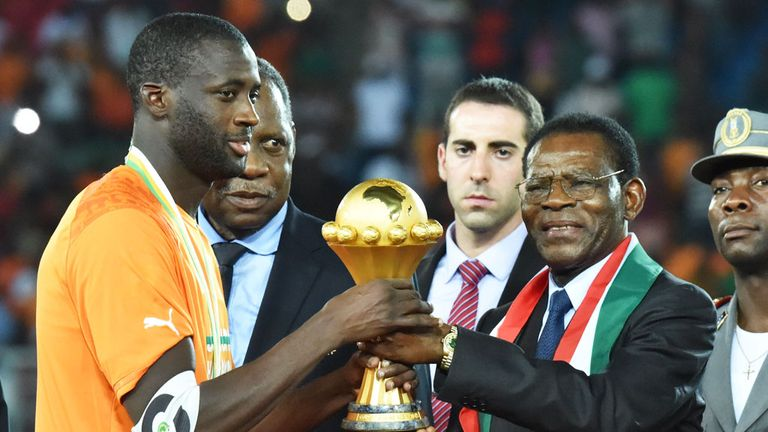 Yaya Toure receives the Africa Cup of Nations after Ivory Coast beat Ghana on penalties