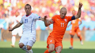 Marcelo Diaz battles with Arjen Robben during a World Cup 2014 match between Chile and the Netherlands.