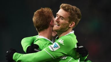 Kevin De Bruyne celebrates a goal with Andre Schuerrle (R)