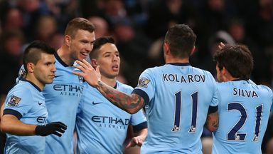 Man City players celebrate with Edin Dzeko after he scores against Newcastle