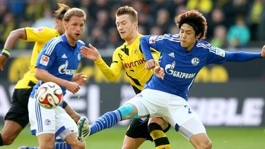 Marco Reus battles for the ball with Atsuto Uchida in Dortmund's win over Schalke