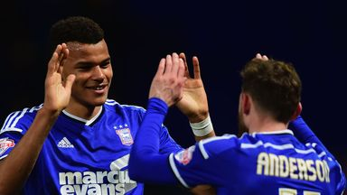 Tyrone Mings (left) celebrates with team-mate Paul Anderson after scoring Town's first goal