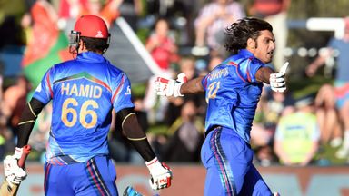 Afghanistan batsman Shapoor Zadran (R) celebrates with teammate Hamid Hassan (L)