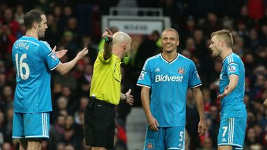 Wes Brown is sent off by referee Roger East at Old Trafford