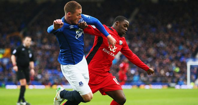 Jeffrey Schlupp of Leicester City battles with James McCarthy of Everton