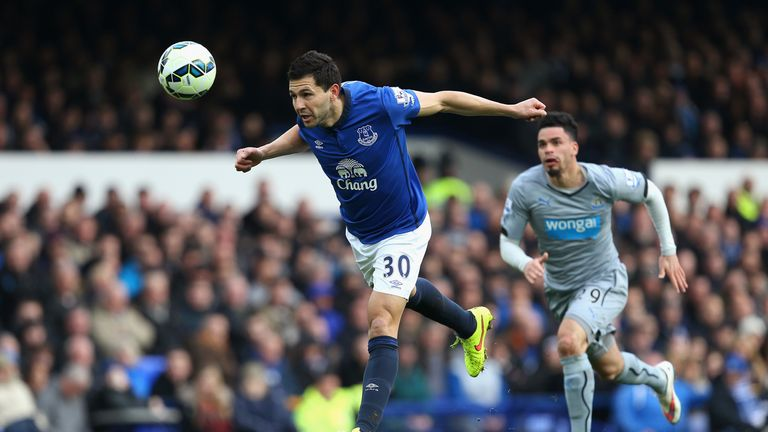 Antolin Alcaraz of Everton heads the ball