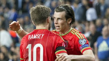 Wales' midfielder Gareth Bale celebrates with teammate Aaron Ramsey