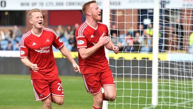 Adam Rooney (r) celebrates with Andrew Driver after firing Aberdeen ahead at Dens Park on Saturday