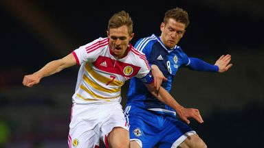 Captain:Darren Fletcher battles with Steven Davis