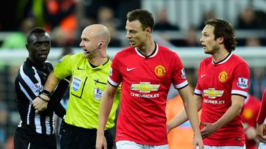 Jonny Evans (C): Involved in 'spitting' incident with Papiss Cisse (L)