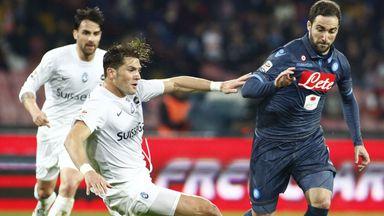 Guglielmo Stendardo tackles Gonzalo Higuain
