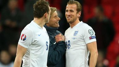 Harry Kane: Happy England striker with Phil Jones (6) and goalkeeping coach Dave Watson