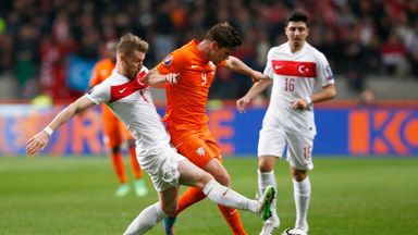 Klaas Jan Huntelaar of Netherlands and Serdar Aziz of Turkey