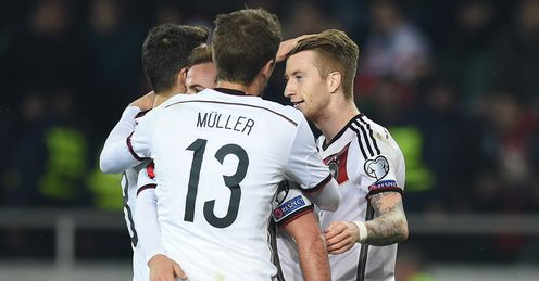 Marco Reus: Celebrates with team-mates after scoring Germany's first goal against Georgia.