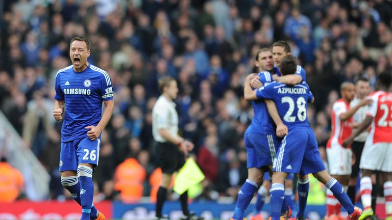 John Terry celebrates after a point at Arsenal puts Chelsea on the brink