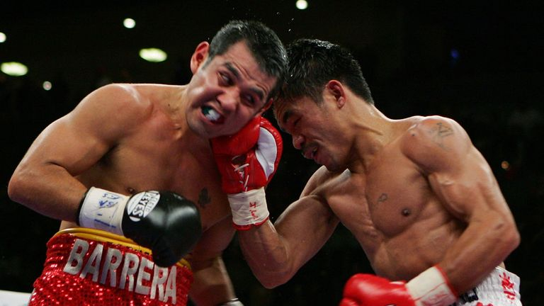 Pacquiao (R) beat Marco Antonio Barrera by unanimous decision in 2007 at super featherweight