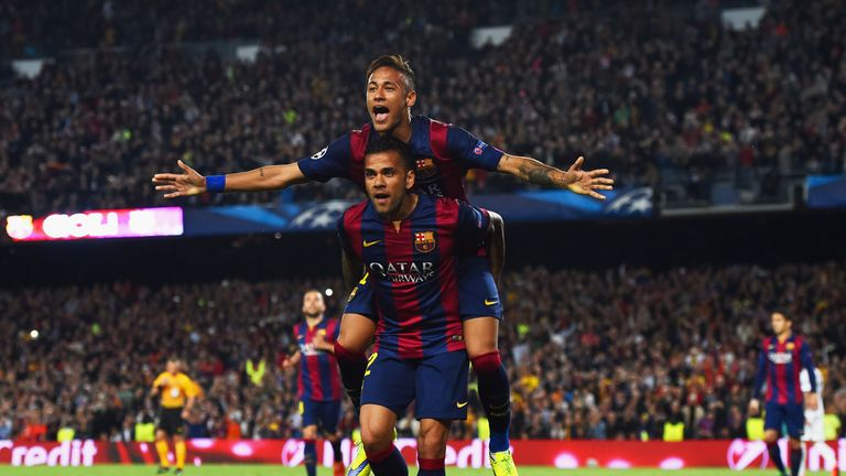 Neymar and Alves celebrate Barca's second