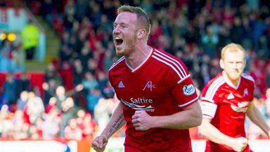 Adam Rooney celebrates putting Aberdeen  1-0 up against Dundee United.