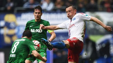 Ivica Olic of Hamburg is challenged by Markus Feulner