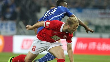 Johannes Geis and Eric Maxim Choupo-Moting battle for the ball
