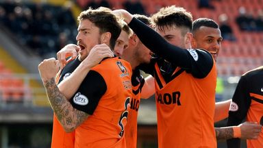 Chris Erskine is mobbed by his Dundee United team mates after scoring the winner against Hamilton.