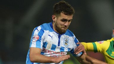 Tommy Smith: Defender extends stay at Huddersfield