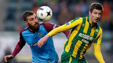 Vitesse's Guram Kashia tussles with Den Haag's Michiel Kramer for possession