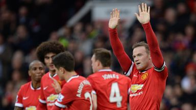 Wayne Rooney (right): Striker says United have met their targets