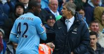 Manchester City manager Manuel Pellegrini chats to Yaya Toure who could be heading for the exit door this summer