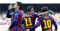 Barcelona's Luis Suarez celebrates his goal against Valencia on the weekend