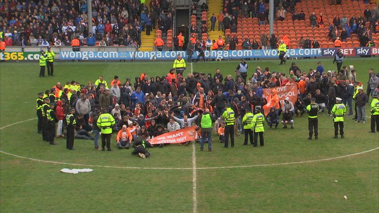 Blackpool fans hold sit-down protest