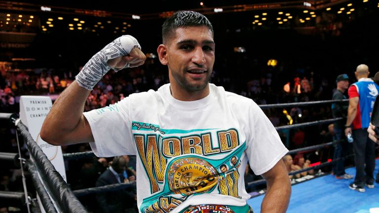 Amir Khan celebrates after defeating Chris Algieri in May