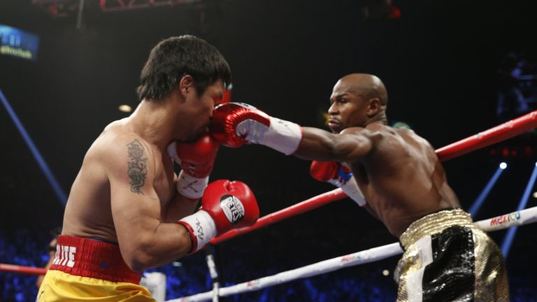 Pacquiao is still adamant he deserved to beat Floyd Mayweather (right)