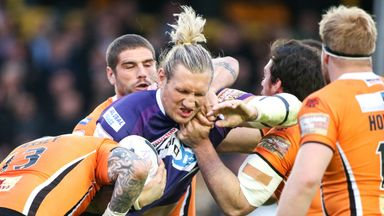 Eorl Crabtree takes on the Castleford's defence.