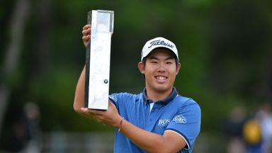 Byeong-hun An celebrates with the trophy after winning the BMW PGA Championship at Wentworth