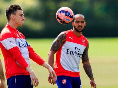 Theo Walcott and Laurent Koscielny enjoy a training session