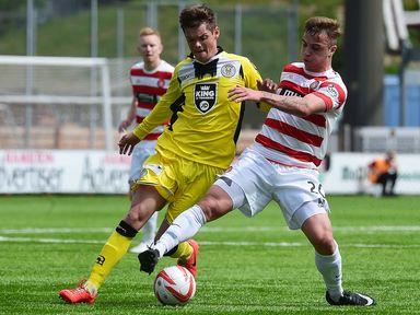 Eamon Brophy puts Thomas Reilly under pressure