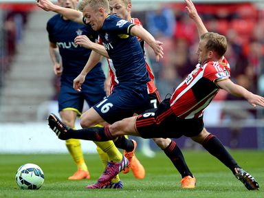 James Ward-Prowse of Southampton is tackled by Sunderland's Lee Cattermole