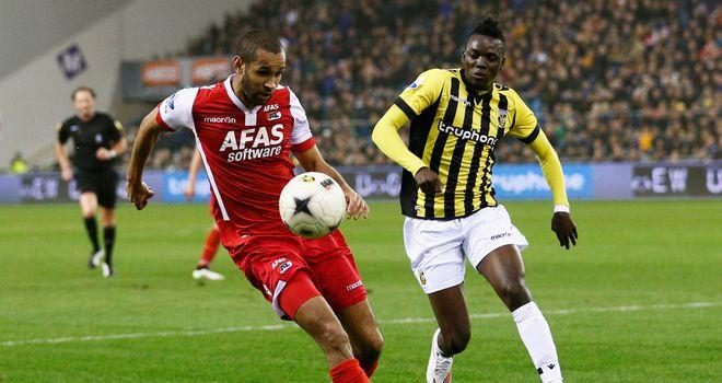 Bertrand Traore of Vitesse and Simon Poulsen of AZ battle for the ball during the Dutch Eredivisie match between Vitesse Arnhem and AZ Alkmaar
