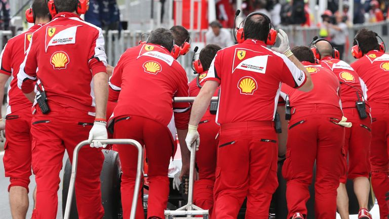 The car of Sebastian Vettel is recovered after stopping on track in Friday practice in Austria