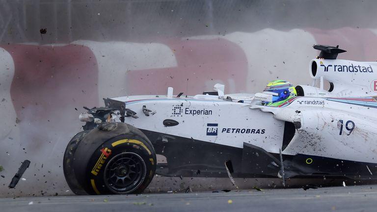 Felipe Massa hits the wall after crashing into Sergio Perez