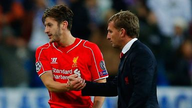 Adam Lallana (left): Delighted that Brendan Rodgers (right) is staying at Liverpool