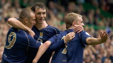 (L-R) Kenny Miller, Christian Dailly and Darren Fletcher celebrate for Scotland