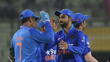 Mahendra Singh Dhoni (L) celebrates with Virat Kohli (R) after winning the third ODI