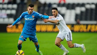Neil Taylor: Left-back has signed a new four-year contract at Swansea City