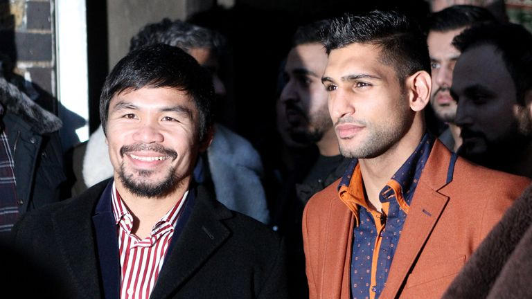 Manny Pacquiao (left) and Amir Khan were stablemates when they trained at the Wild Card gym under Freddie Roach