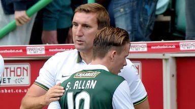 Alan Stubbs speaks to Scott Allan following Hibs